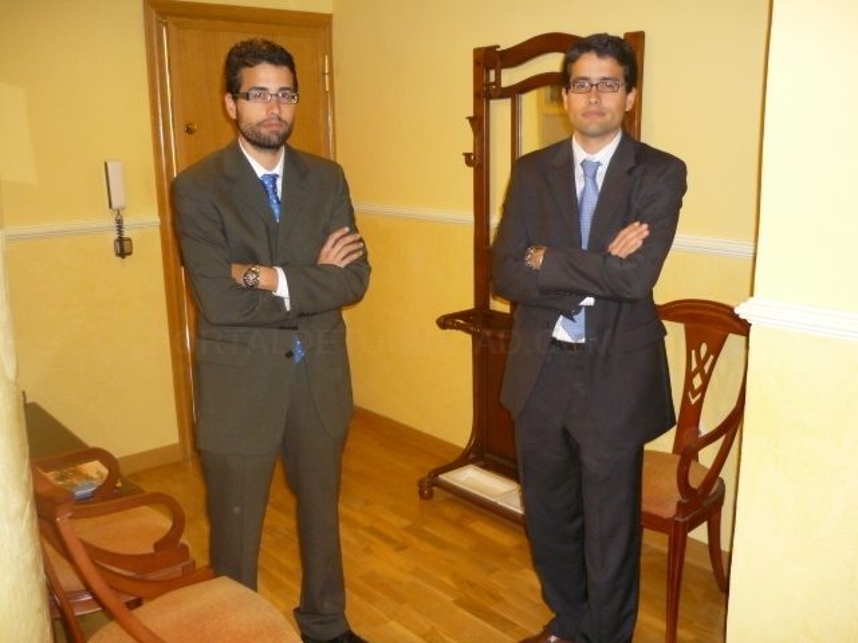 abogados román y román cáceres