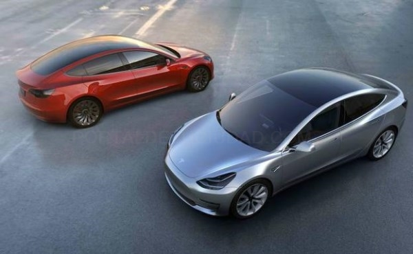 DOS COCHES MODEL 3 DE TESLA. / AFP