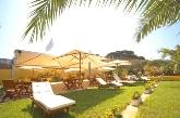 solarium, hotel con piscina cubierta en Mercadal