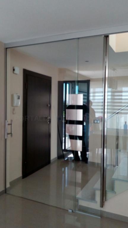 cortina de cristal a medida para terrazas, cerramientos de cristal sin marco en riba roja